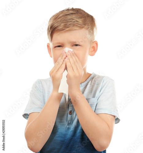 Valokuvatapetti Little boy with nose wiper on white background. Allergy concept