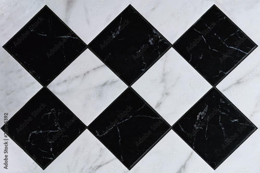 Fototapeta Fragment of black and white tile floor