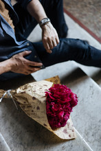 Man Waiting On Stairs With Bouquet