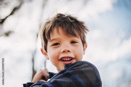 Portrait of a smiling boy on a swing