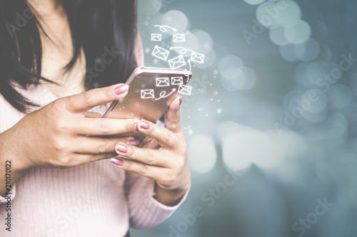 business woman hand sending email by smart phone , internet technology with people
