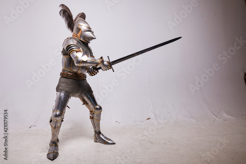 Knight in armor on white background Canvas Print