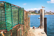Rusty Fishing Traps, Made Of Iron Bars And Green Nylon Nets, Piled Up On A Dock  A Pier In Cascais, Portugal