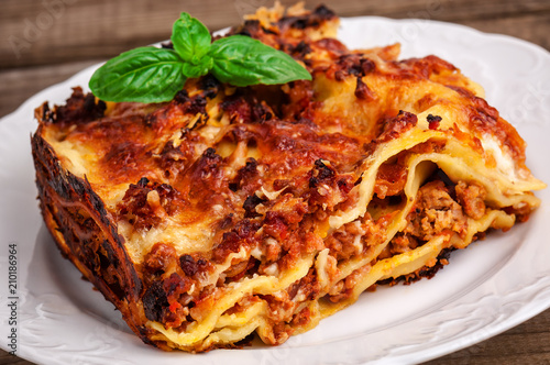 Fototapeta delicious meat lasagna with basil obraz