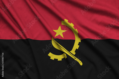 Angola flag  is depicted on a sports cloth fabric with many folds. Sport team banner