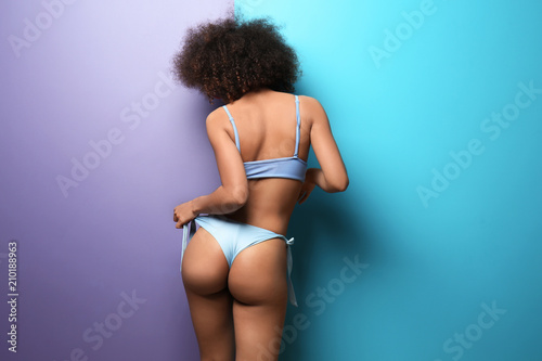 Obraz Beautiful African-American woman in bikini on color background - fototapety do salonu