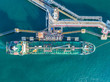 canvas print picture - oil tanker, gas tanker in the high sea.Refinery Industry cargo ship,aerial view,Thailand, in import export, LPG,oil refinery, Logistics and transportation with working crane bridge in harbor