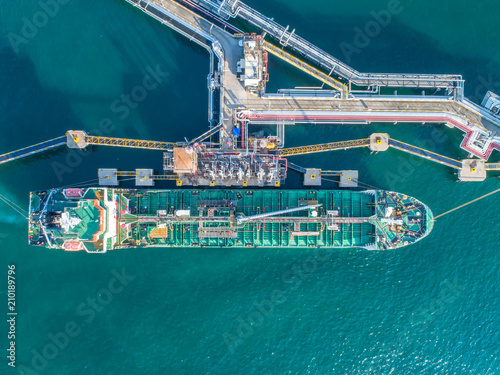 Fototapeta oil tanker, gas tanker in the high sea.Refinery Industry cargo ship,aerial view,Thailand, in import export, LPG,oil refinery, Logistics and transportation with working crane bridge in harbor obraz