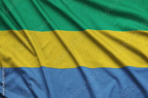 Fotografie, Obraz  Gabon flag  is depicted on a sports cloth fabric with many folds