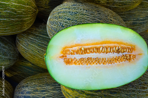Heap of Big Ripe Organic Green and Yellow Spanish Frogs Skin Melons Mediterranean Farmers Market. Viivid Colors. Summer Harvest. Vitamins Superfoods Healthy Diet Concept. Sunlight Flecks. Close up