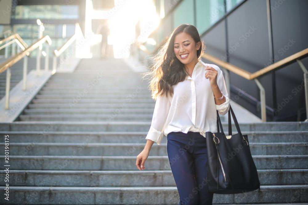 Fototapety, obrazy: Beautiful woman walking in the street