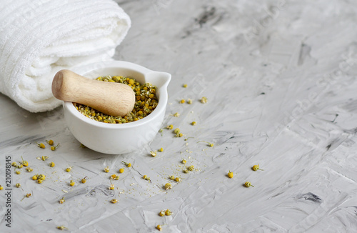 Foto op Plexiglas Spa Dried chamomile flowers, natural ingredients for homemade body, face salt scrub, mask, SPA concept