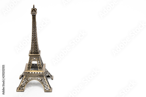 Deurstickers Eiffeltoren miniature model of a golden Eiffel tower on a white background (mock-up)