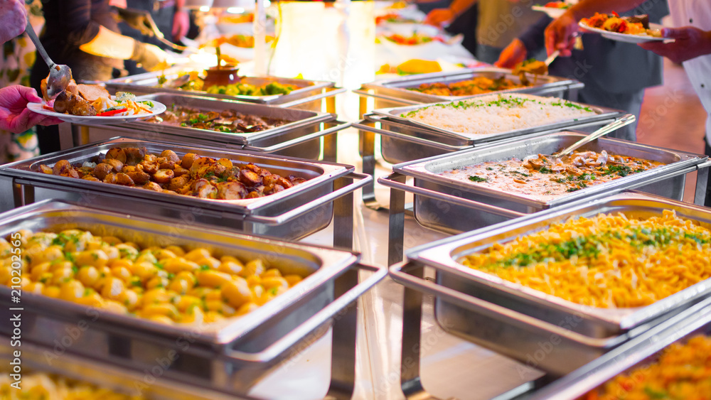 Fototapeta People group catering buffet food indoor in luxury restaurant with meat colorful fruits and vegetables.