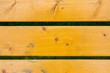 three yellow painted boards