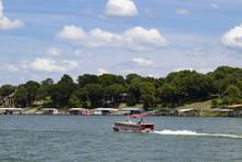 Pontoon Boat Motoring Out Past...