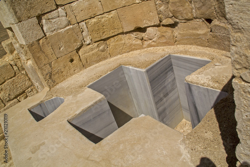 Fotografie, Tablou Baptistmal Cross Shaped Font in Avdat Ancient Nabataean Settleme