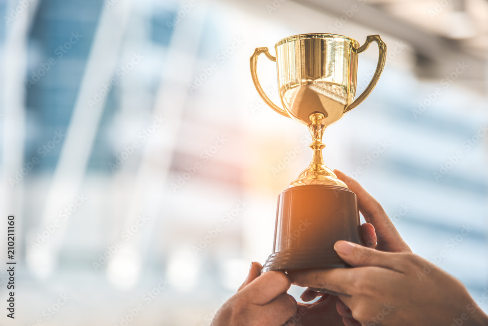 Fototapeta Champion golden trophy for winner background. Success and achievement concept. Sport and cup award theme.