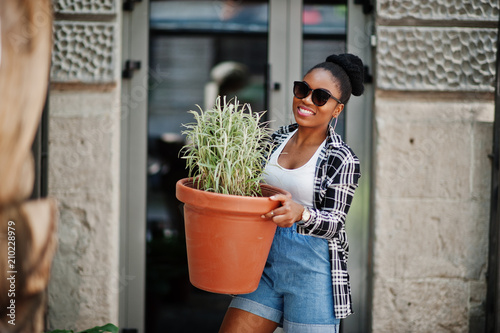 6d7139797b5 Hip hop african american girl on sunglasses and jeans shorts. Casual street  fashion portrait of