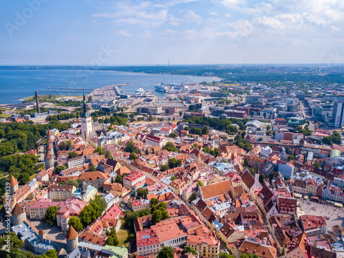 Foto op Aluminium Luchtfoto Amazing aerial view of the Tallinn old town with many old houses sea and castle on the horizon.