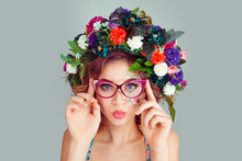 Woman With Dianthus Flowers Head Floral Headband Blowing Lips Air Kiss