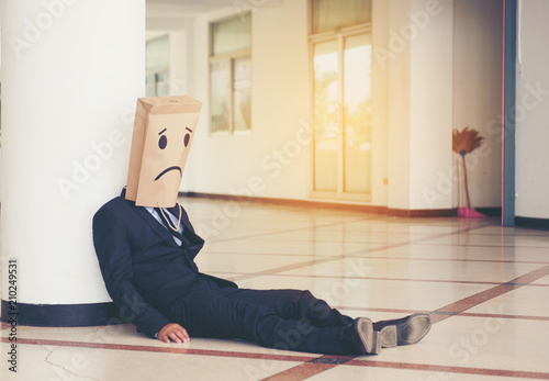 Fotografia Businessman with a sad mask At the office