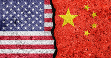 Flags Of USA And China Painted On Cracked Wall Background/USA-China Trade War Concept