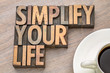 canvas print picture - simplify your life - word asbtract in wood type
