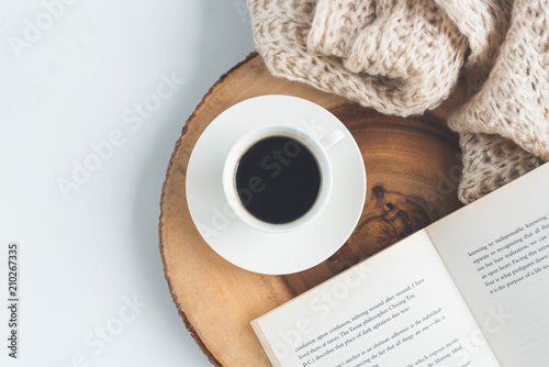 Cup of coffee and book on the table