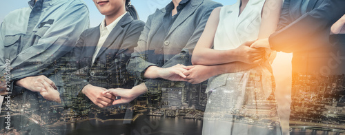 Double exposure business people holding hands. Wallpaper Mural