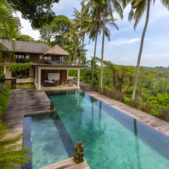 Relaxing area at infinity swimming pool in tropical island Bali, Indonesia