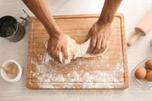 Man Kneading Dough On Table