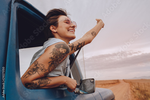 Leinwand Poster Attractive young woman enjoying on a road trip