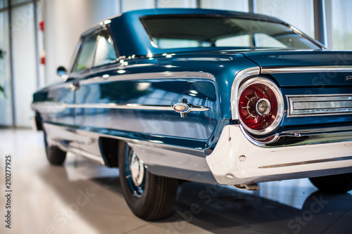 Keuken foto achterwand Vintage cars Chrome rear tail lights, bumper and exhaust of convertible turquoise vintage car