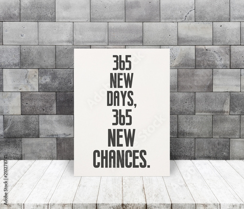 Fotografia, Obraz  Inspiration Quote 365 new days, 365 new chances on paper at wooden table top and old stone brick wall background