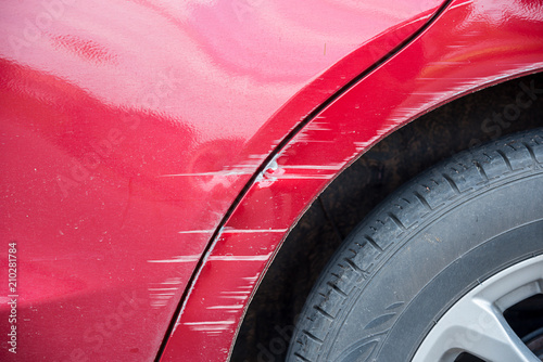 Obraz scratched on red car by the accident - fototapety do salonu