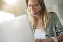 Business Girl In Office Using Headset