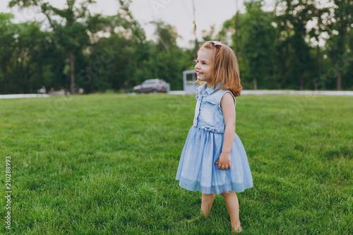 2929ef031acf Pretty little cute child baby girl in denim dress standing