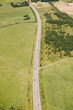 Aerial view of the road on a sunny morning in the summer. Latvia.