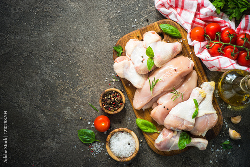 Raw chicken meat assortment - fillet, wings and drumstics.