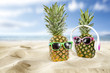 summer photo of pineapple on sand