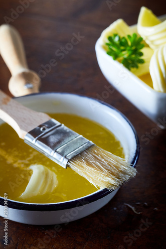 Bowl of melted butter with a basting brush Wallpaper Mural