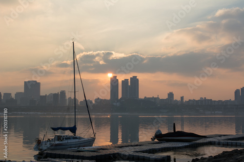 Boats on han river at sunset Poster