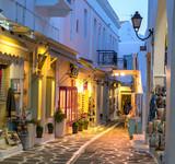 Fototapeta Uliczki - Touristic narrow street with souvenirs shops in the evening