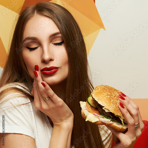 Portrait of playful beautiful sexy woman with red lips