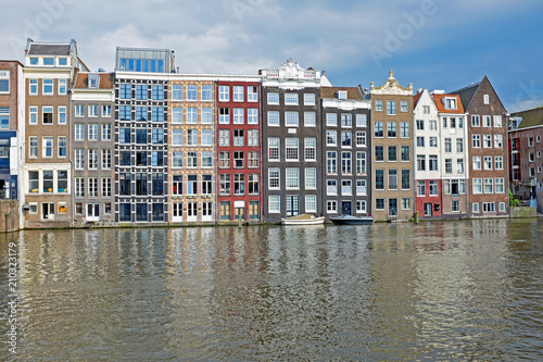 Poster Amsterdam Traditional historical dutch houses at the waterfront in the city Amsterdam in the Netherlands