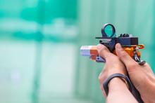 Man Hold A Competition Gun Aim...