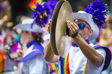 Man In A Marching Band Smashes The Symbols Together In The Annual Pride Parade As It Passes Through Greenwich Village.
