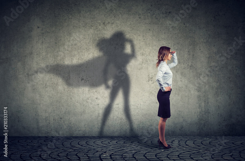 Fototapeta Brave business woman posing as super hero obraz