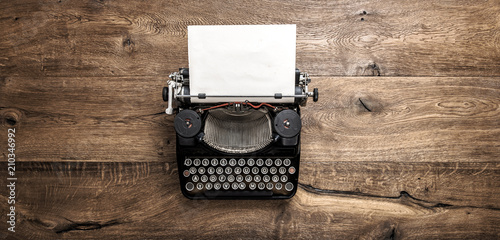 Antique typewriter grungy textured paper wooden background